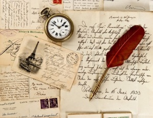 old letter and post cards with feather quill